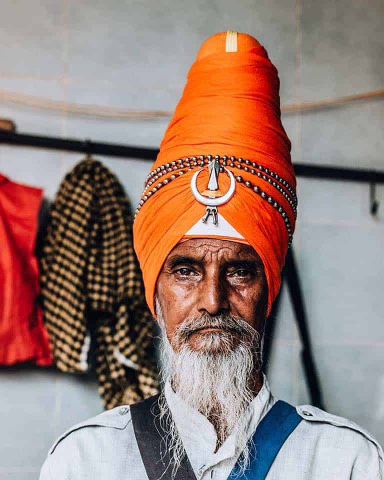A Portrait of a Sikh with a big beard.