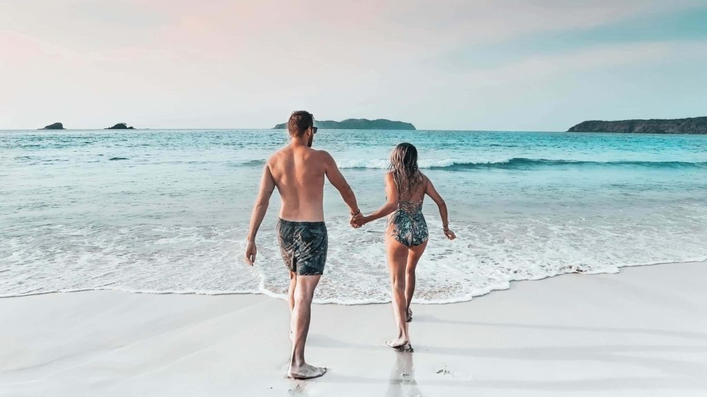 The best things to do in the Philippines: A couple is holding hands at the beach
