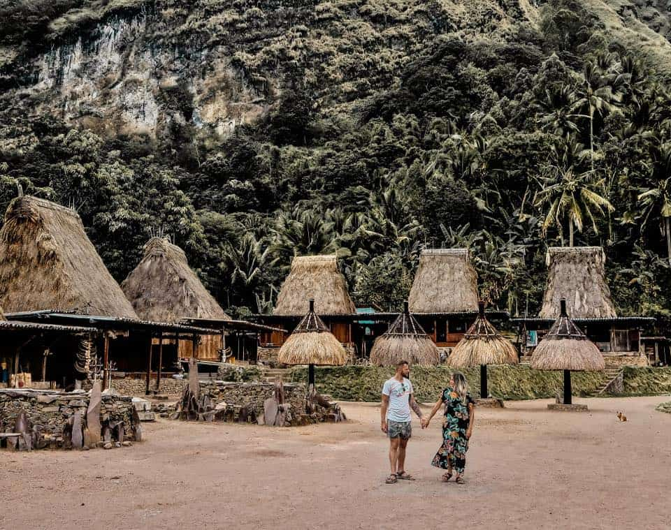 Flores Guide: a couple holding hands in the Bajawa village