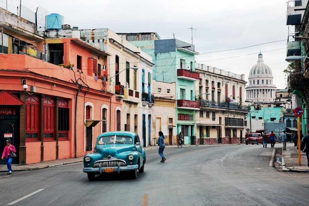 Havana Cuba: street scene with an old timer and colonial buildings in Havana Cuba