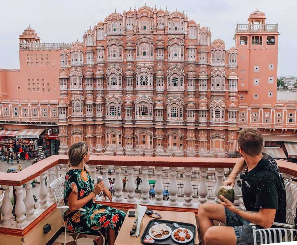 Jaipur Guide: A man and a woman sitting in front of the wind palace in Japur.