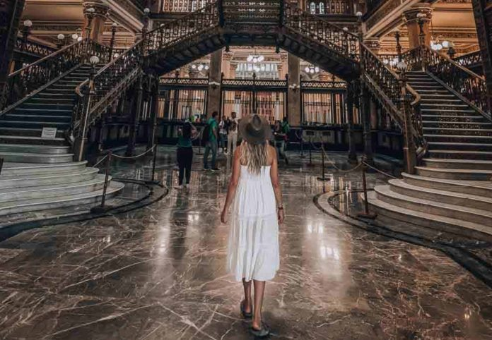Mexico City Travel Guide: A girl is standing in the historical post office of Mexico City
