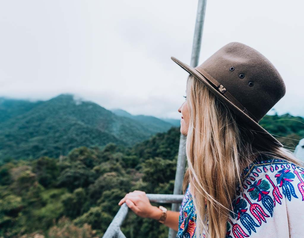 Mindi Guide: A girl is enjoying the view from the cable car