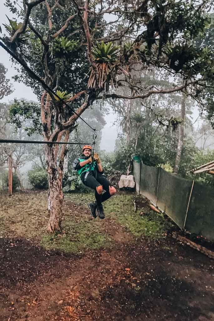 Mindo Guide: a man is doing zip lining