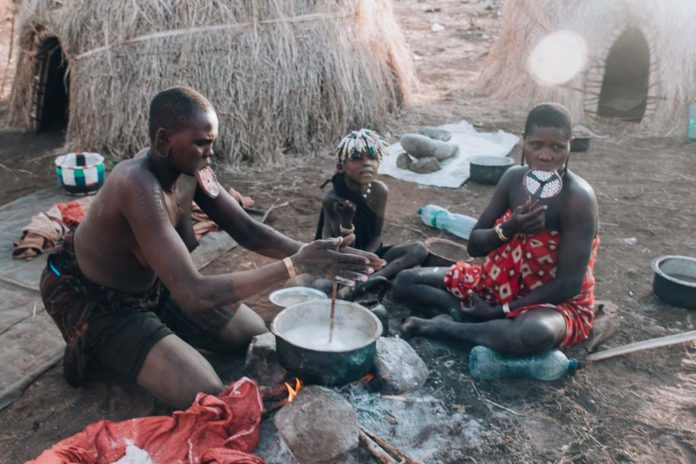 Omo Valley Mursi Tribe Women are cooking