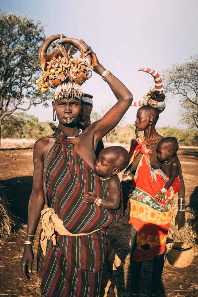 Omo Valley Mursi tribe women with babies