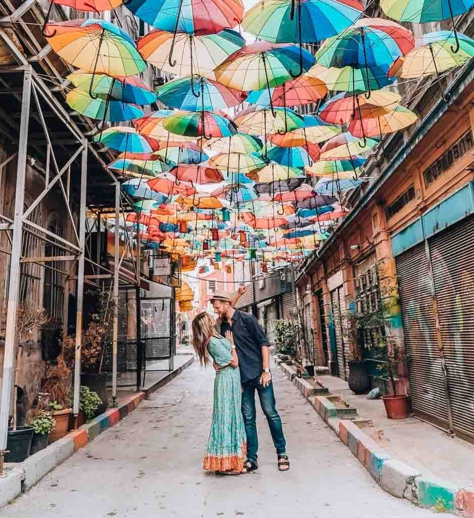 A couple is looking at each other underneath an umbrella roof in Karaköy